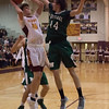 Westlake forward Anthony Rego attempts to block Avon Lake post Creed Bologna's shot. Jen Forbus -- The Morning Journal