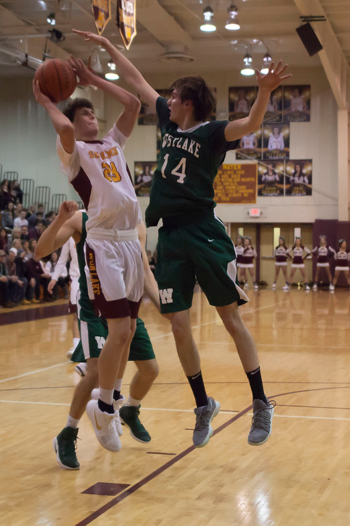 . Westlake forward Anthony Rego attempts to block Avon Lake post Creed Bologna\'s shot. Jen Forbus -- The Morning Journal
