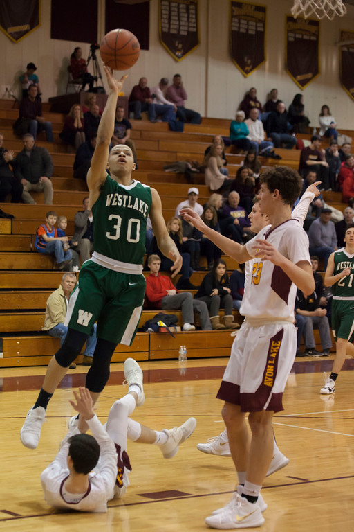 . Avon Lake\'s Nick Vittardi takes on the roll of speed bump trying to slow Westlake\'s Tim Waite on his drive to the net. Jen Forbus -- The Morning Journal