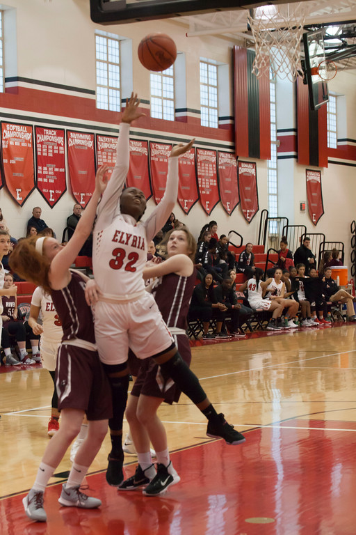 . Elyria forward Tylese Noble works her way through several Pirates to put a shot up. Jen Forbus -- The Morning Journal
