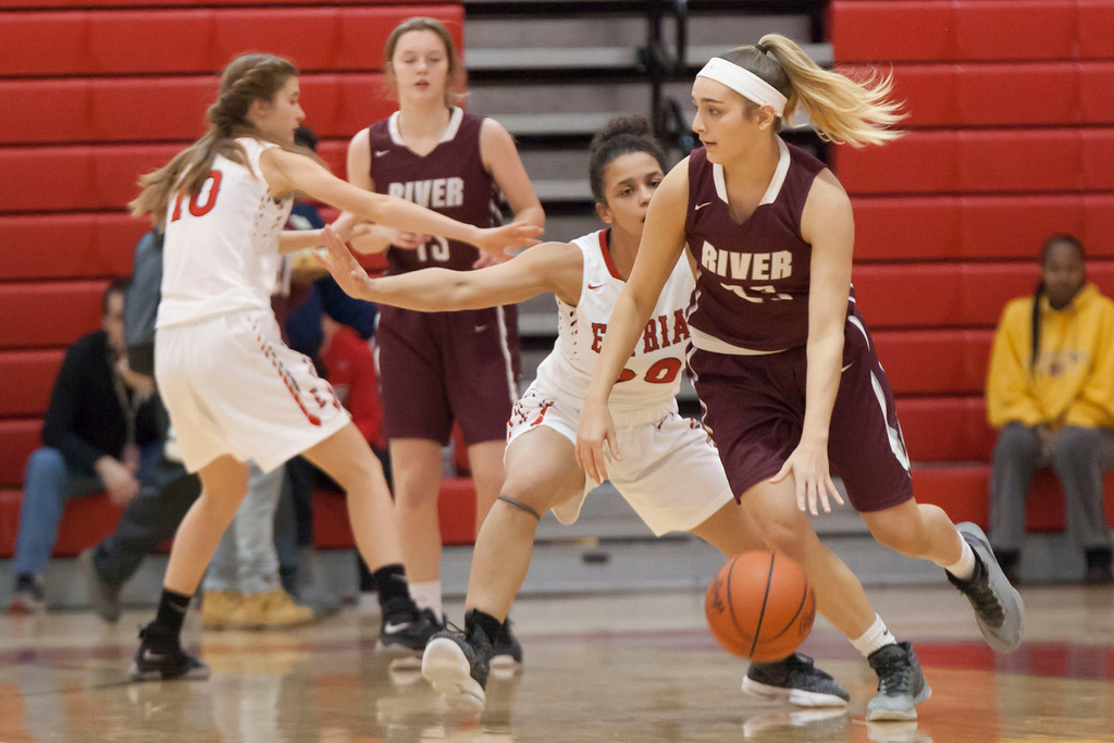. Rocky River\'s Hanna Chapman tries to make her way past Elyria\'s Tiffany Means. Jen Forbus -- The Morning Journal