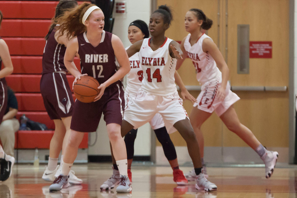 . Elyria\'s Toni McClinton (14) closes off Rachel Moeller\'s (12) path inside, so she looks for help from her fellow Pirates. Jen Forbus -- The Morning Journal