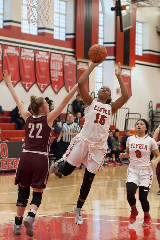 . Elyria\'s Chelsey Farris (15) gets by River\'s Bridget McCue (22) to launch a shot. Jen Forbus -- The Morning Journal