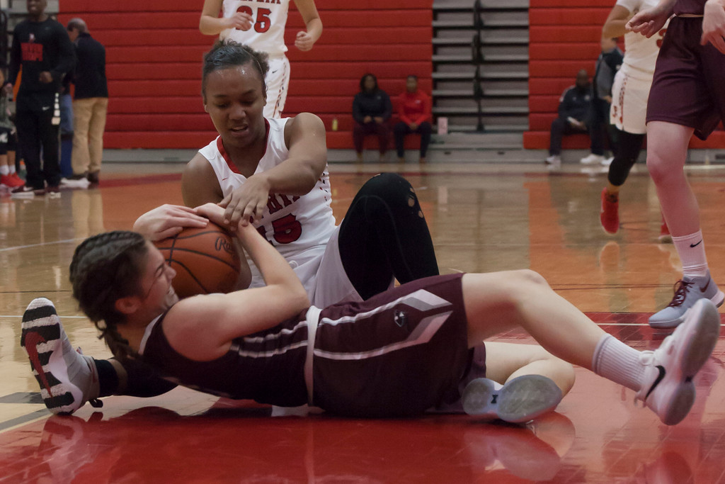 . Elyria\'s Chelsey Farris and Rocky River\'s Anne Beirne wrestle for the basketball. Jen Forbus -- The Morning Journal