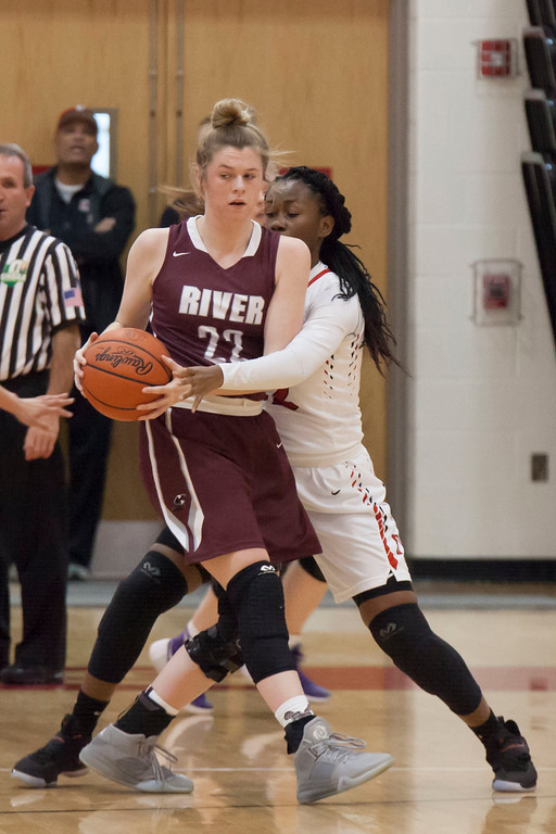 . Surrounded on all sides by Elyria\'s Tylese Noble, Rocky River\'s Bridget McCue looks for her teammates. Jen Forbus -- The Morning Journal
