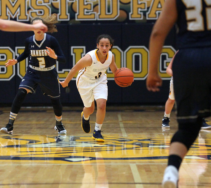 Olmsted Falls guard Mayand Alhashash brings the ball up court through the North Ridgeville defenders. Randy Meyers -- The Morning Journal