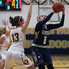 Izzy Geraci of North Ridgeville eyes the basket before scoring over Chloe Akins of Olmsted Falls during the third quarter. Randy Meyers -- The Morning Journal