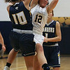 Rachael Vance of Olmsted Falls grabs a rebound away from Dani Blagojevic of North Ridgeville during the second quarter. Randy Meyers -- The Morning Journal