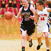 S1219BASKET3<br /> Skyline's #14, Kylie Emanuel, defends as Silver Creek's #12, Taylor Strub, drives to the paint during their game at Skyline Highschool on Tuesday evening, December 18th, 2012.<br /> <br /> Photo by: Jonathan Castner