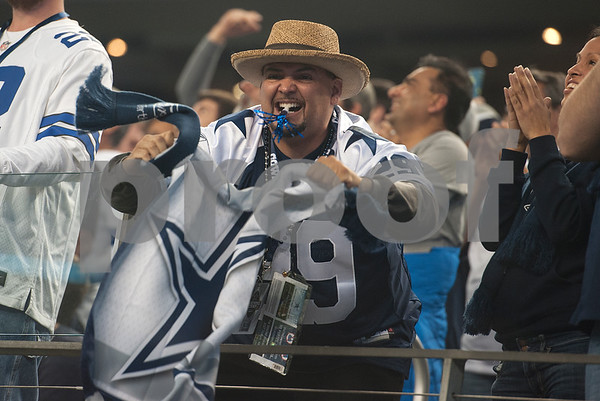 photo by Sarah A. Miller/ Tyler Morning Telegraph  A Dallas Cowboy fan celebrates after a touchdown during their game Sunday against the Indianapolis Colts at home at AT&T Stadium in Arlington, Texas.