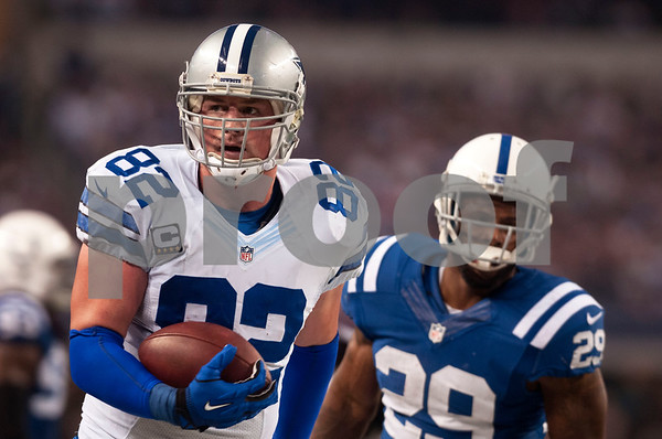 photo by Sarah A. Miller/ Tyler Morning Telegraph  Dallas Cowboys tight end Jason Witten (82) carries the ball with Indianapolis Colts player Mike Adams (29) close behind during their game Sunday Dec. 21, 2014 at AT&T Stadium in Arlington, Texas.