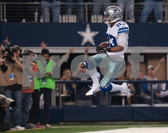 photo by Sarah A. Miller/ Tyler Morning Telegraph  Dallas Cowboy's Terrance Williams (83) jumps after running into the end zone to score a touchdown in the second half of their game Sunday against the Indianapolis Colts at home at AT&T Stadium in Arlington, Texas.