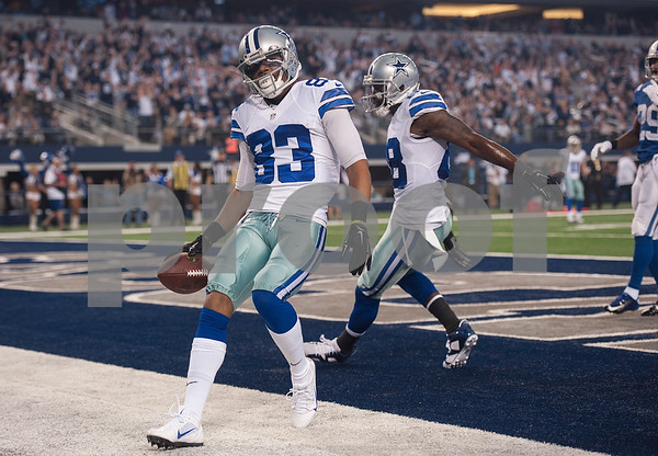 photo by Sarah A. Miller/ Tyler Morning Telegraph  Dallas Cowboy's Terrance Williams (83) scores a touchdown during their game Sunday against the Indianapolis Colts at home at AT&T Stadium in Arlington, Texas.