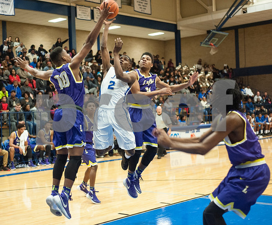 John Tyler's (2) Bryson Smith shoots a ball over Lufkin's (10) Kenan Jackson Friday night Jan. 22, 2016 at home.  (Sarah A. Miller/Tyler Morning Telegraph)