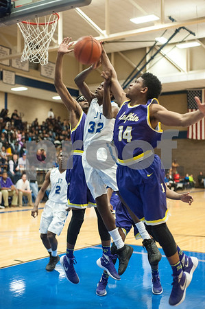 Lufkin's (14) JeQuarius Houston knocks the ball away from John Tyler's (32) Mashaud Moore Friday night Jan. 22, 2016 at home.  (Sarah A. Miller/Tyler Morning Telegraph)