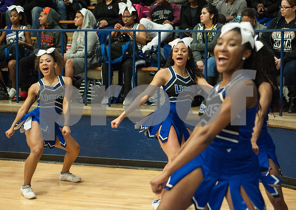 The John Tyler High School cheerleading team cheers on the Lions boys as they play Lufkin Friday night Jan. 22, 2016 at home.  (Sarah A. Miller/Tyler Morning Telegraph)