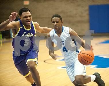 Lufkin's Royce Kenebrew follows John Tyler's Christerpher Lee as he dribbles down the court Friday night Jan. 22, 2016 at home.  (Sarah A. Miller/Tyler Morning Telegraph)