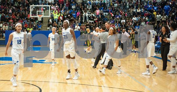 The John Tyler girls basketball team celebrates after defeating Lufkin Friday night Jan. 22, 2016 at home.  (Sarah A. Miller/Tyler Morning Telegraph)