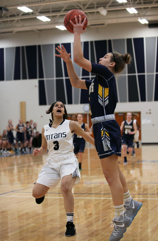 . Isabella Geraci scores with the left hand over Normajanae Bohannon of Lorain during the first quarter. Randy Meyers -- The Morning Journal