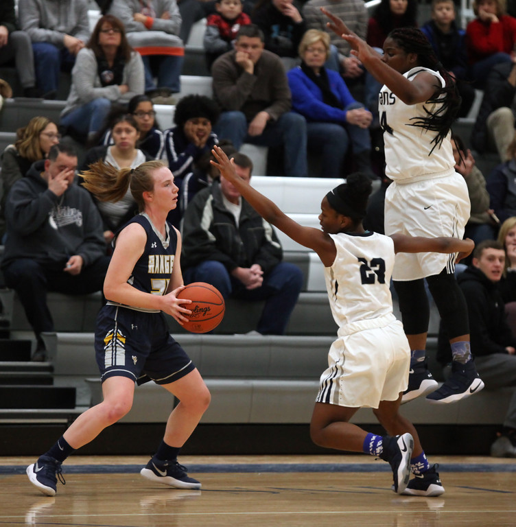 . Lorain\'s Mikiya Hermon and Nemaja \'Grant pressure Lauren Milner of North Ridgeville in the back court. Randy Meyers -- The Morning Journal