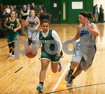 Bishop T. K. Gorman's (4) Raven Roberson dribbles the ball with Dallas Thunder's (30) Shekinah Nelson close by during their game Tuesday in the Macy Chenevert Patriot Classic held at Bishop Thomas K. Gorman Catholic School.  (Sarah A. Miller/Tyler Morning Telegraph)