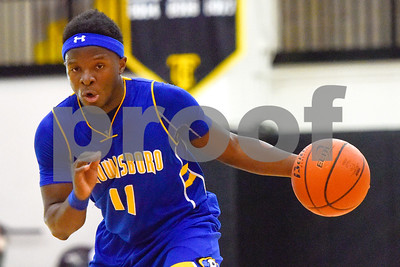 Brownsboro senior Kevon Thompson (11) dribbles the ball during the Wagstaff Holiday Classic at Tyler Junior College in Tyler, Texas, on Friday, Dec. 29, 2017. (Chelsea Purgahn/Tyler Morning Telegraph)