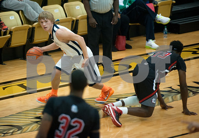 photo by Sarah A. Miller/Tyler Morning Telegraph  Brook Hill's Chase McDermott (5) dribbles the ball downcourt Tuesday Dec. 30, 2014 during their basketball game against Kilgore in the Wagstaff Holiday Classic held at Tyler Junior College's Wagstaff Gymnasium.