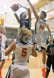 photo by Sarah A. Miller/Tyler Morning Telegraph   Kilgore High School basketball player X'aviar Gaona (0) aims for a basket as Brook Hill's Jake Anderson (14) blocks Tuesday Dec. 30, 2014 during their game in the Wagstaff Holiday Classic held at Tyler Junior College's Wagstaff Gymnasium.