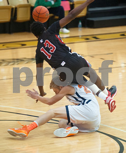 photo by Sarah A. Miller/Tyler Morning Telegraph  A Kilgore High School basketball player is tripped up by Brook Hill's Phillip Kitt (20) Tuesday Dec. 30, 2014 during their game in the Wagstaff Holiday Classic held at Tyler Junior College's Wagstaff Gymnasium.