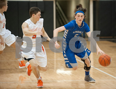 Lindale's (2) Laettner Greenhill dribbles the ball with Brook Hill's (5) Colton Adams at his side during their game Wednesday Dec. 30, 2015 in the Wagstaff Holiday Classic.  (Sarah A. Miller/Tyler Morning Telegraph)