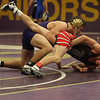 Vermilion's Jakob Koleszar forces Nathan Thompson of Firelands to the mat during the 132- pound match at the Vermilion holiday tournament. Koleszar won the match with a pin. Randy Meyers -- The Morning Journal