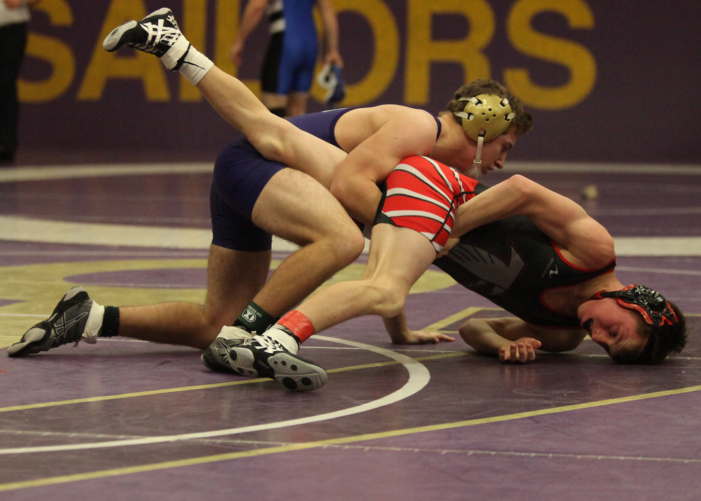 . Vermilion\'s Jakob Koleszar forces Nathan Thompson of Firelands to the mat during the 132- pound match at the Vermilion holiday tournament. Koleszar won the match with a pin. Randy Meyers -- The Morning Journal