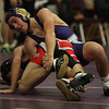 Vermilion's Brandon D'Egidio uses a leg hold on Ben Britton during the 106lb match at the Vermilion holiday tournament. Randy Meyers -- The Morning Journal