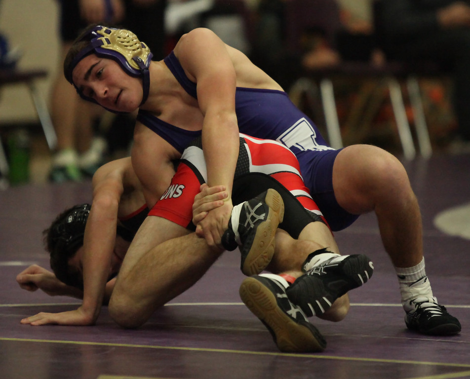 . Vermilion\'s Brandon D\'Egidio uses a leg hold on Ben Britton during the 106lb match at the Vermilion holiday tournament. Randy Meyers -- The Morning Journal