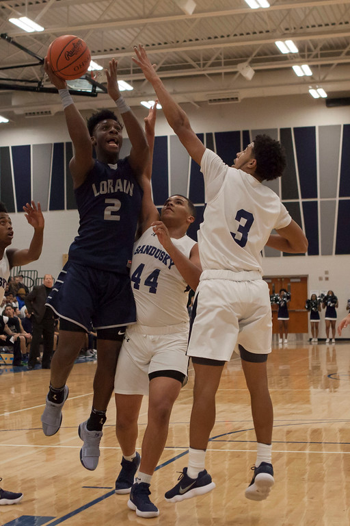 . Lorain forward Taevon Pierre-Louis takes the ball to the basket against Sandusky. Jen Forbus -- The Morning Journal