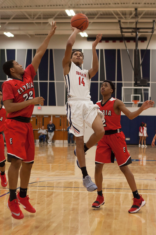 . Oberlin\'s Azarie Hairston puts up a jump shot against Elyria. Jen Forbus -- The Morning Journal