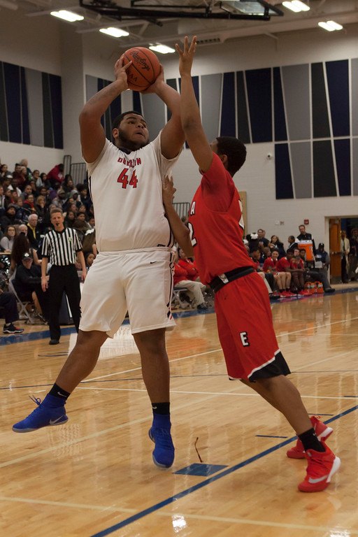 . Elyria\'s Izaiah Thomas isn\'t giving Oberlin\'s David Hopkins any room as he tries to shoot. Jen Forbus -- The Morning Journal