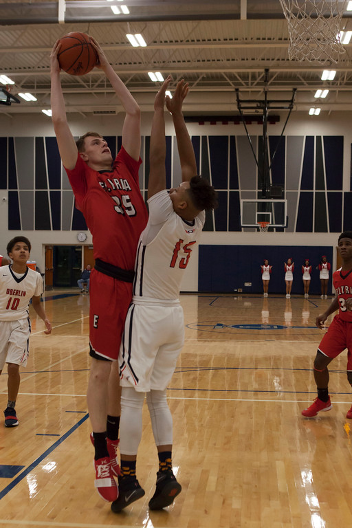 . Elyria post Justin Koepp goes up for a shot as Oberlin forward Aaron Hopkins defends. Jen  Forbus -- The Morning Journal
