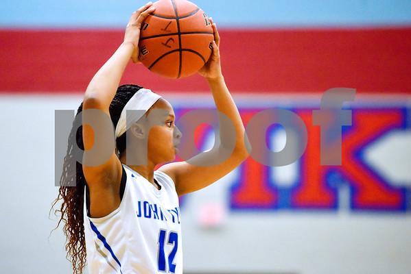 John Tyler's Zakiyah Jones (12) looks to pass the ball during a high school basketball game at Boulter Middle School in Tyler, Texas, on Tuesday, Jan. 23, 2018. (Chelsea Purgahn/Tyler Morning Telegraph)