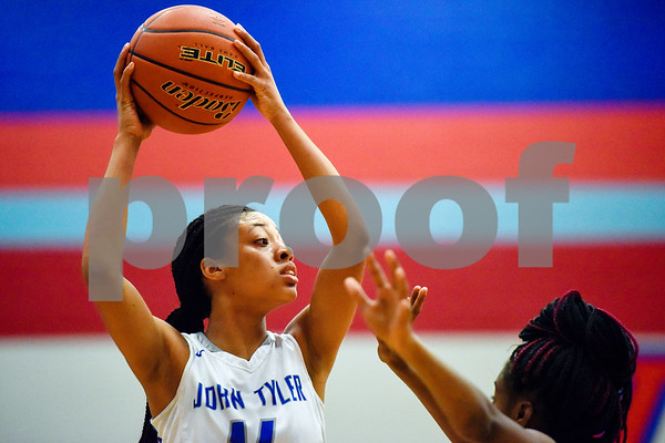 John Tyler's Jazmyne Hicks (14) looks to pass the ball during a high school basketball game at Boulter Middle School in Tyler, Texas, on Tuesday, Jan. 23, 2018. (Chelsea Purgahn/Tyler Morning Telegraph)