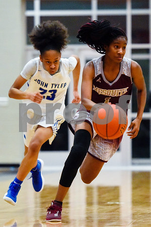John Tyler's Amara Davis (23) runs after Mesquite's Lakeycia Bables (1) during a high school basketball game at Boulter Middle School in Tyler, Texas, on Tuesday, Jan. 23, 2018. (Chelsea Purgahn/Tyler Morning Telegraph)