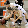 Monarch's Jordan Eisler (back) and Reagenm Rohn (front) race Fossil Ridge's Savannah Smith for a loose ball during their basketball game at Monarch High School in Louisville, Colorado January 24, 2012.  CAMERA/MARK LEFFINGWELL