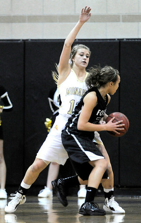 Monarch's Ashton Davis (left) blocks Fossil Ridge's Gabrielle Smith (right) during their basketball game at Monarch High School in Louisville, Colorado January 24, 2012.  CAMERA/MARK LEFFINGWELL