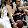 Monarch's Jac Malcolm-Peck (left) and Fossil Ridge's Lauren Roeling (right) fight for a rebound during their basketball game at Monarch High School in Louisville, Colorado January 24, 2012.  CAMERA/MARK LEFFINGWELL