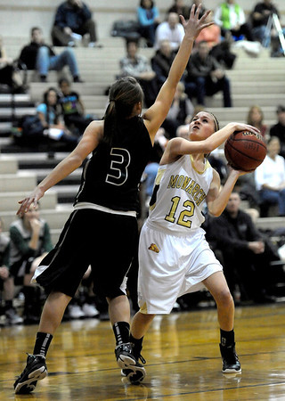 Monarch's Brenna Stimac (right) looks to shoot while being guarded by Fossil Ridge's Savannah Smith (left) during their basketball game at Monarch High School in Louisville, Colorado January 24, 2012.  CAMERA/MARK LEFFINGWELL