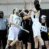 Monarch's Mae Williams (left) and Bridget Anthony (right) pressure Fossil Ridge's Savannah Smith (middle) during their basketball game at Monarch High School in Louisville, Colorado January 24, 2012.  CAMERA/MARK LEFFINGWELL