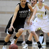 Monarch's Brenna Stimac (right) bumps Fossil Ridge's Lauren Roeling (left) during their basketball game at Monarch High School in Louisville, Colorado January 24, 2012.  CAMERA/MARK LEFFINGWELL