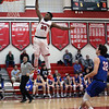 Elyria's Deviian Williams slams the ball off of a fast break in front of Bay's Nick Cady during the first quarter. Randy Meyers -- The Morning Journal