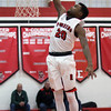 Elyria's Deviian Williams dunks the ball in front of the Bay bench during a first quarter. Randy Meyers -- The Morning Journal