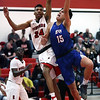 Bay's RJ Sunahara puts up an off balance shot over Darquan Woods of Elyria during the second quarter. Randy Meyers -- The Morning Journal